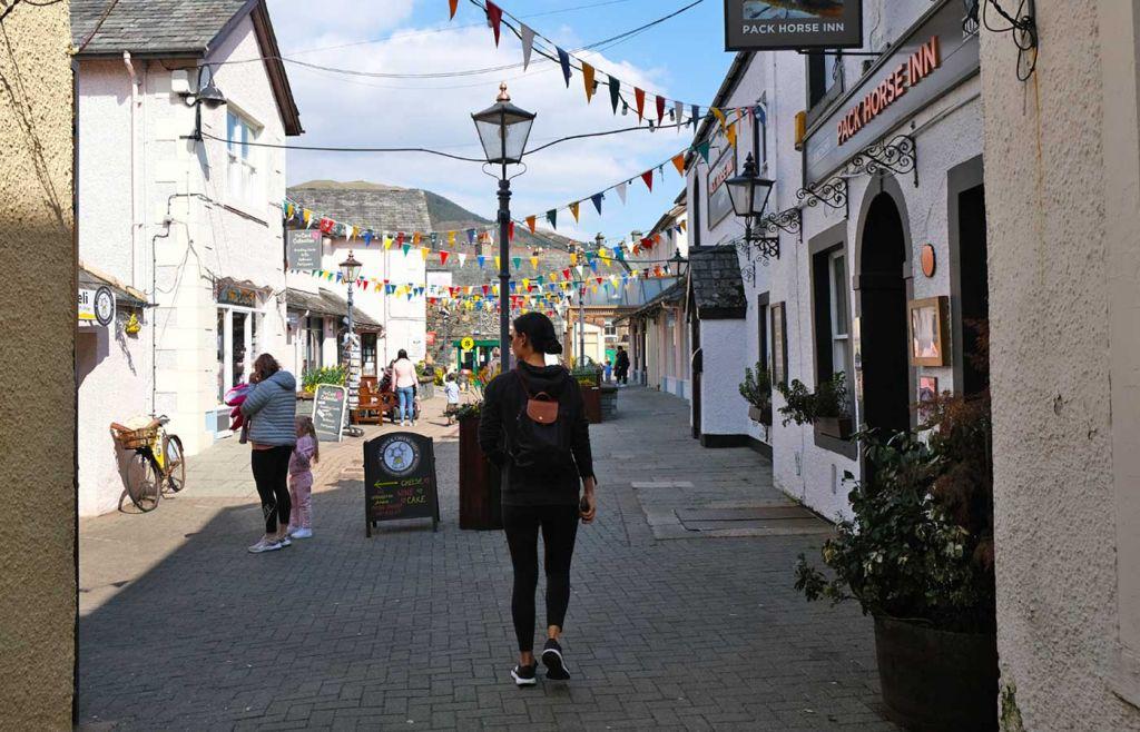 Shows Susie walking through Keswick town