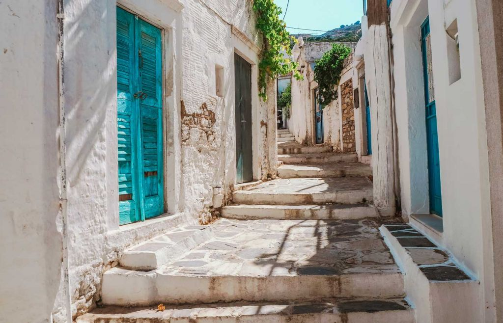 The best Greek islands for couples - Shows a quaint street in Naxos