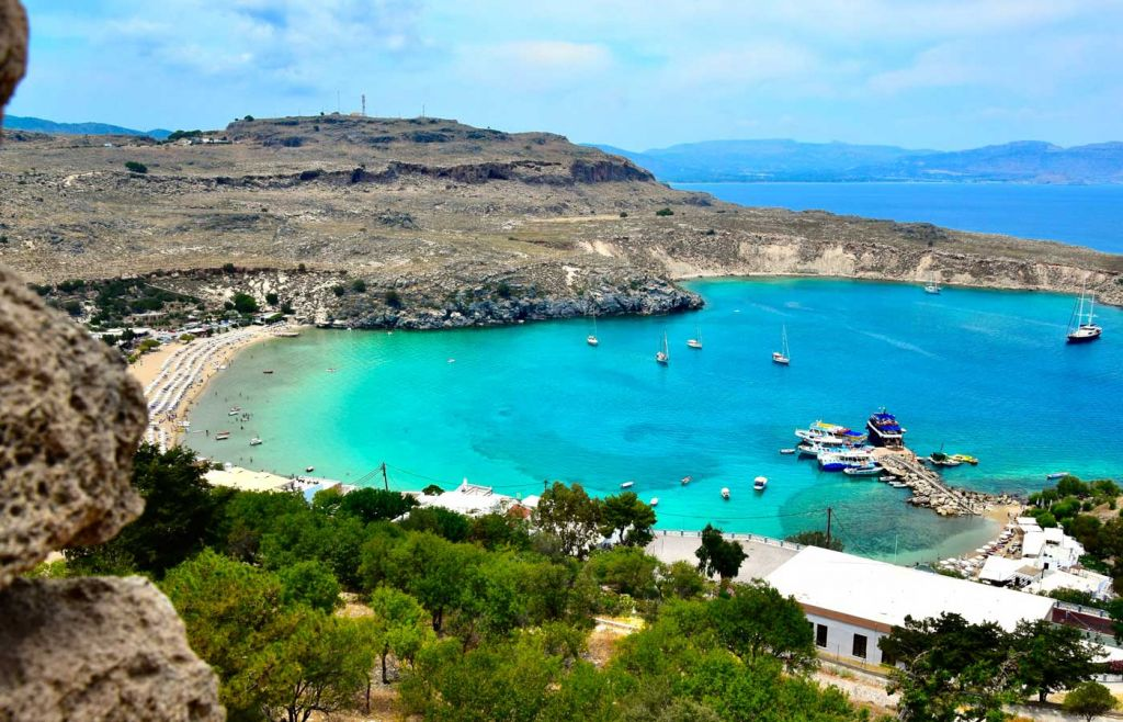 The best Greek islands for couples - Shows a small lagoon in Lindos