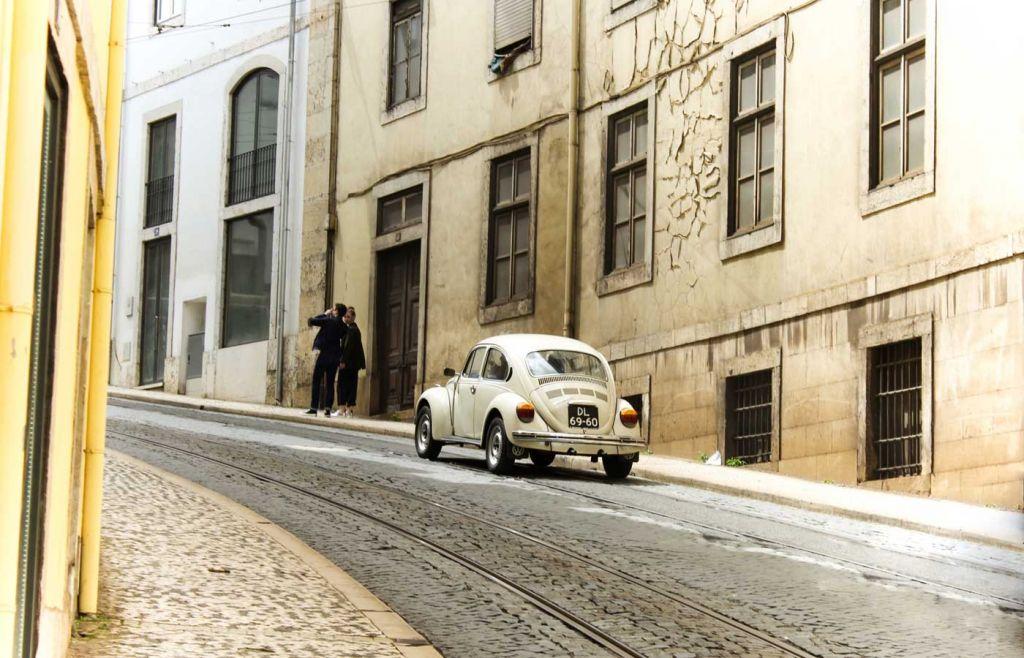 Algarve car rental - Old car on a narrow street