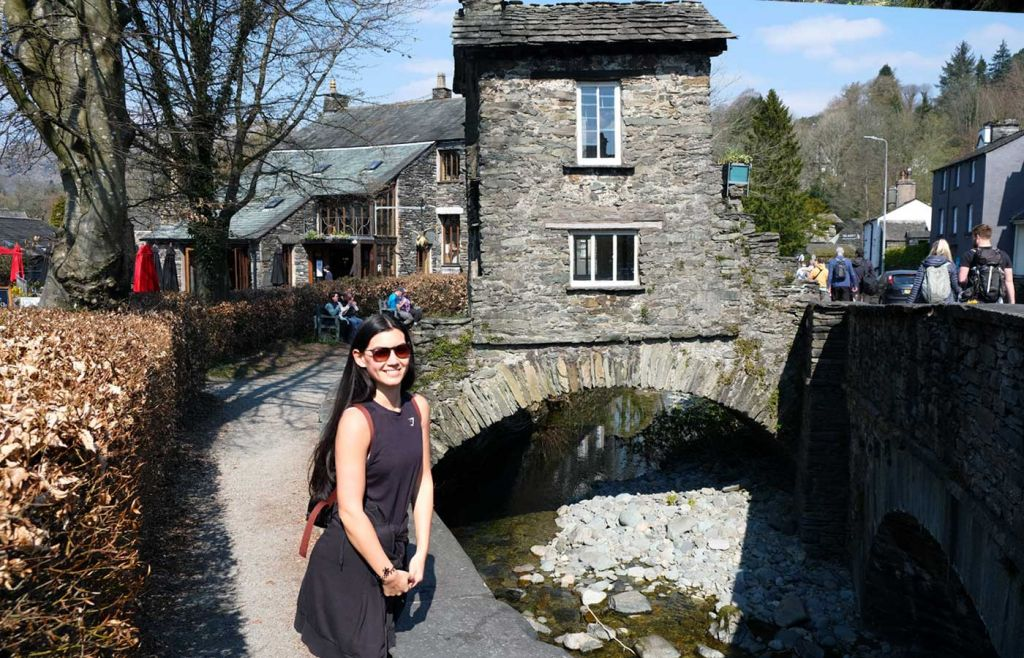 Things to do in Ambleside - Susie standing by The Bridge House