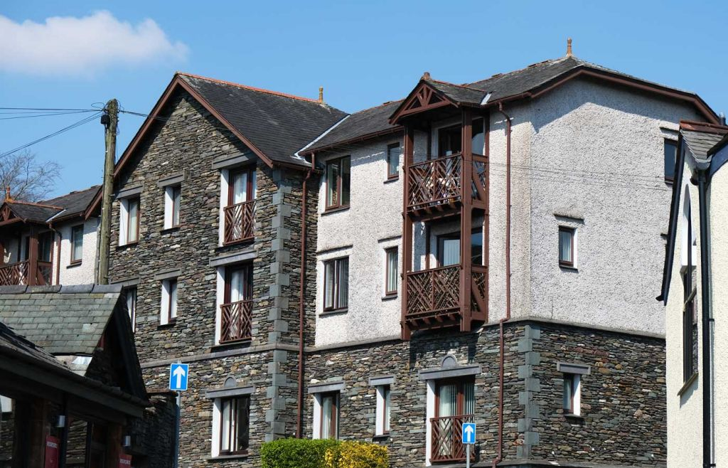 Where to stay in Ambleside Lake District - Shows a riverside hotel