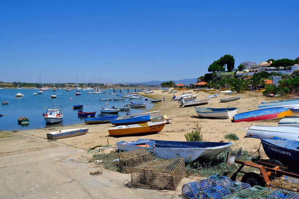 Fishing boats docked on Alvor Beach - Best places to visit in the Algarve