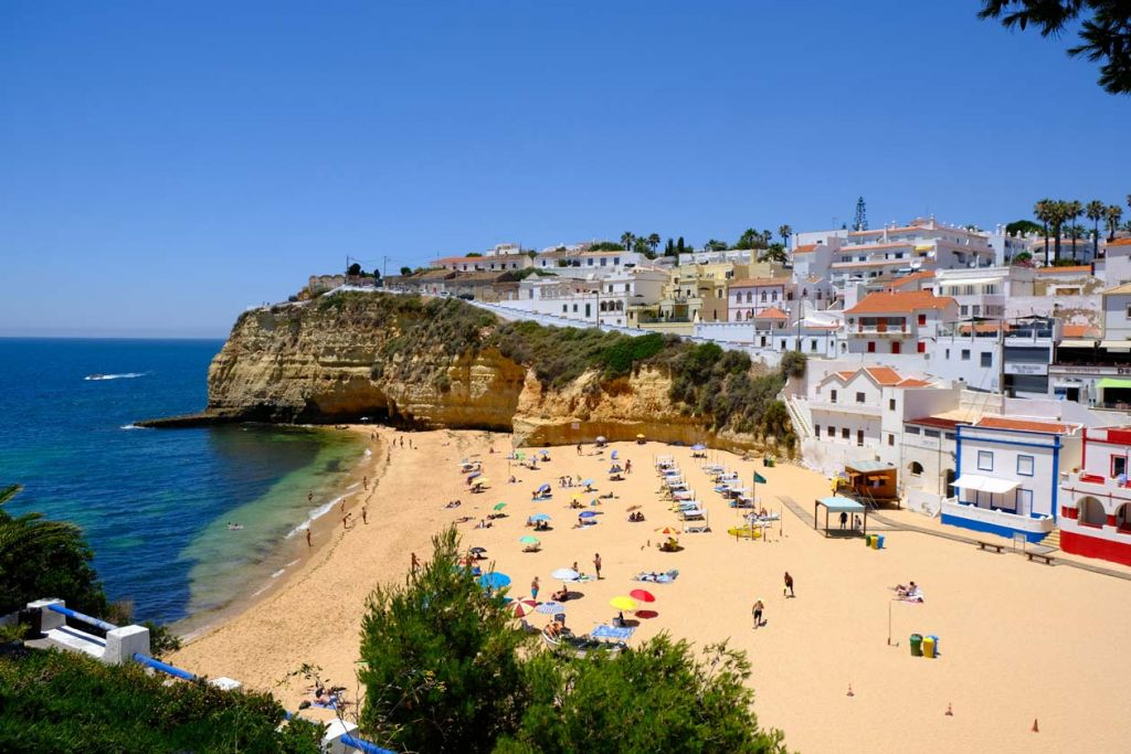 Best places to visit in the Algarve - Carvoeiro town beach