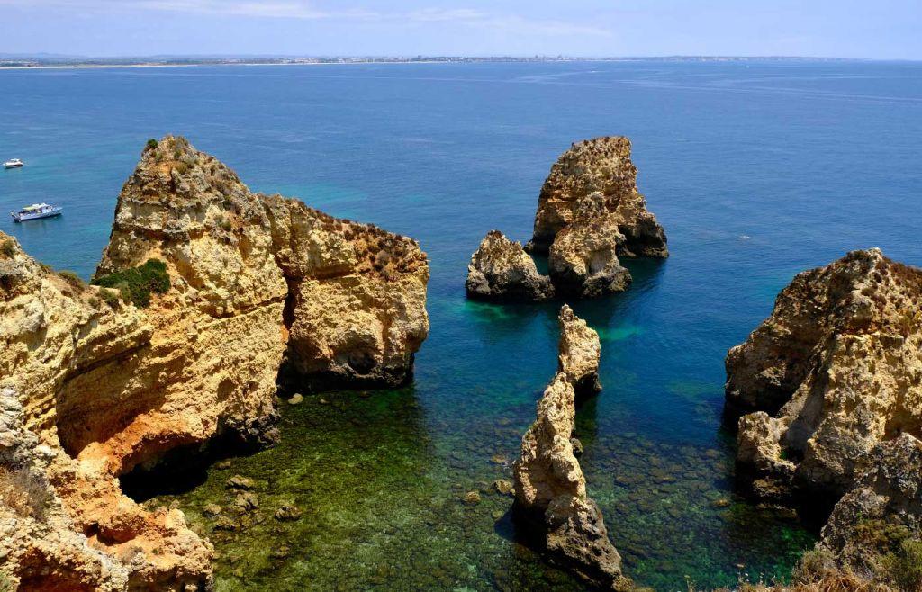 Shows Ponta da Piedade attraction cliffs
