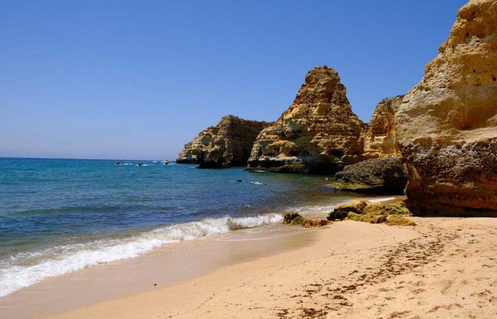 Praia da Marinha sand and cliffs