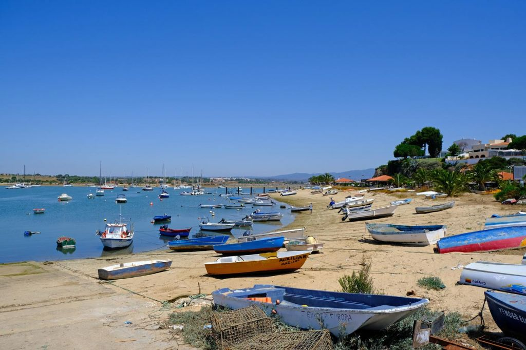 Best things to do in Alvor - A variety of colourful boats at Alvor harbour