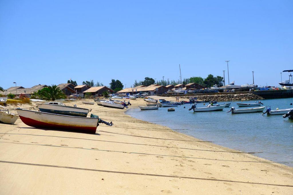 Boats scattered across the beach sand