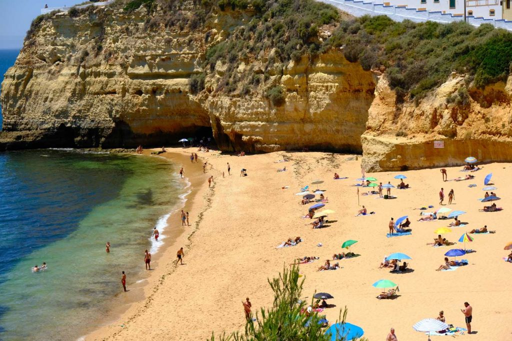 The best Carvoeiro hotels - Shows people relaxing on a beach