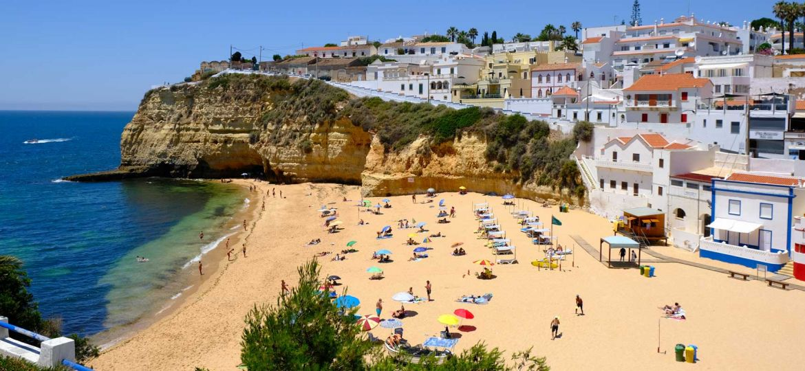 Where to stay in the Algarve - Shows Carvoeiro town and beach